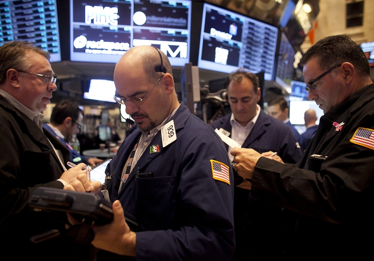 Image: Traders work on the floor of the NYSE